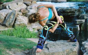 Forrest Yoga Intensive - Charmaine in Interlock yoga pose